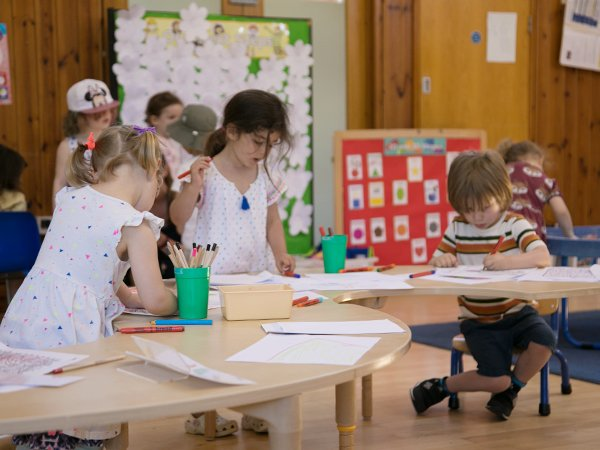 Children drawing on a table indoors