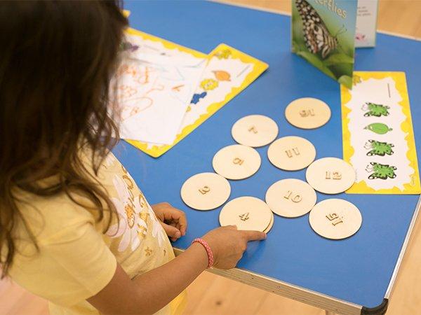 Three old year girl using number circles